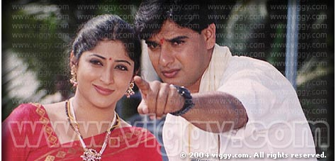 Lakshmi Gopalaswamy and Naveen Mayur in film Poorvapara