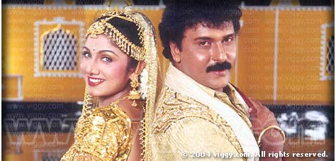 Rambha and Ravichandran in film Sahukara